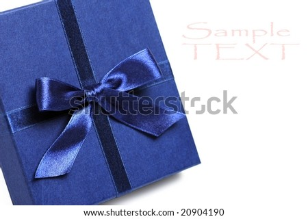 gift box with blue holiday bow. shallow DOF - stock photo