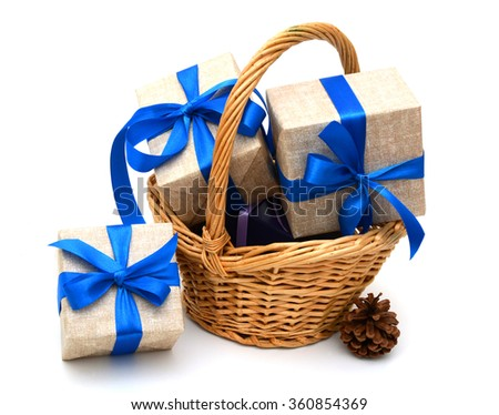 Gift box with blue ribbon bow and basket
