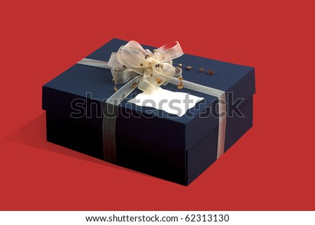 gift box with decorative bow  on red background