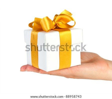 gift box with gold ribbon in hand isolated on white - stock photo
