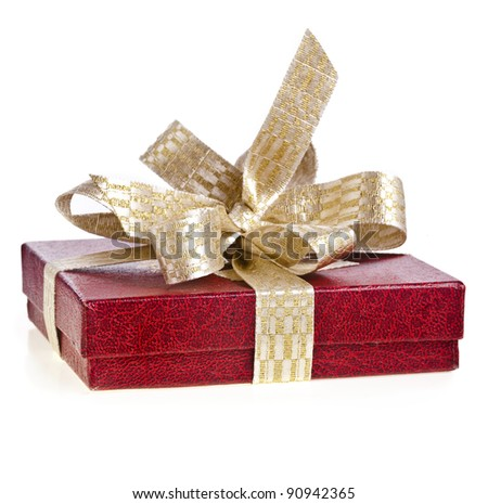 gift box with golden ribbon bow isolated on white - stock photo