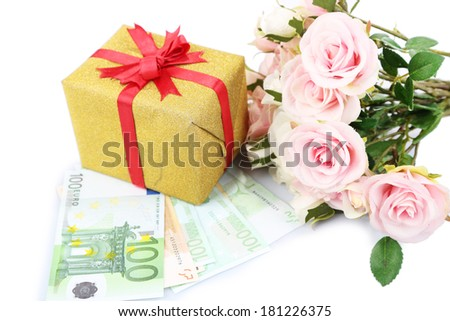 Gift box with money and flowers isolated on white - stock photo