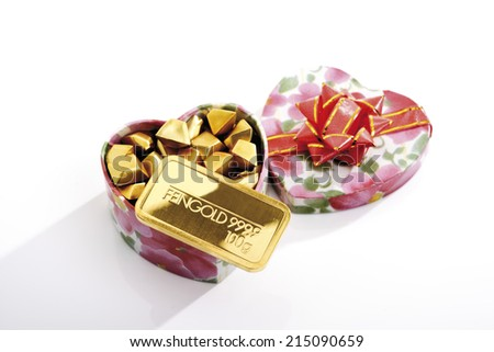 Gift box with nuggets and gold bar - stock photo