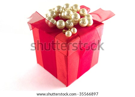 Gift box with pearls - stock photo