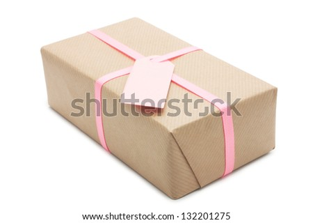 gift box with pink ribbon. isolated on white background. used in the design of a paper label.