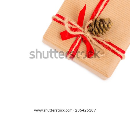 Gift box with red bow and cone isolated on white background, copy space - stock photo
