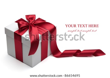 Gift box with red ribbon and bow isolated on the white background, clipping path included. - stock photo