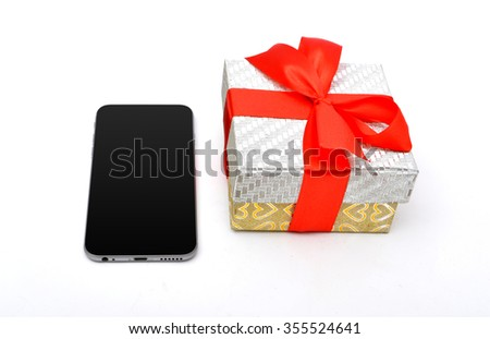 Gift box with red ribbon and smart phone isolated
