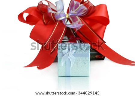 Gift box with red ribbon in background, New year gift box - stock photo