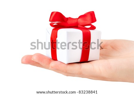 gift box with red ribbon in hand - stock photo
