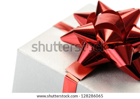 gift box with red ribbon on white background, closeup