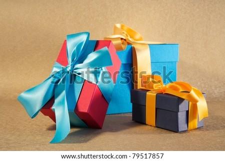 gift box with ribbon and bow at still life - stock photo