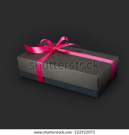 Gift box with ribbon and bow isolated on the Black background, clipping path included.  - stock photo