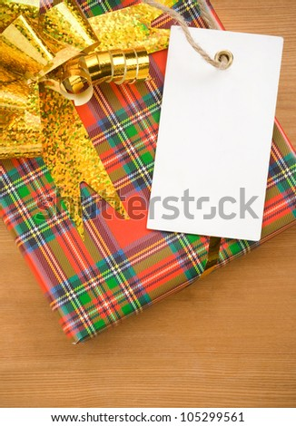 gift box with ribbon and tag price label - stock photo