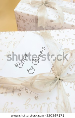 Gift box with ribbon bow for wedding, selective focus. - stock photo