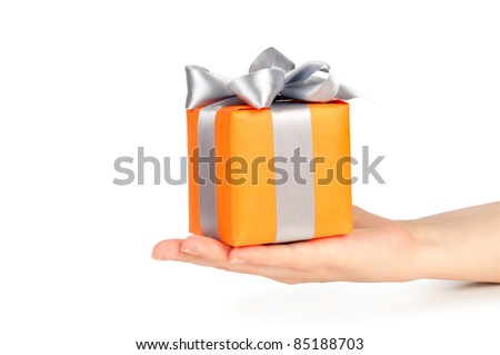 gift box with ribbon in hand