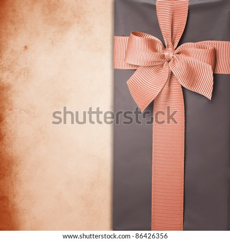 gift box with ribbon on grunge background - stock photo