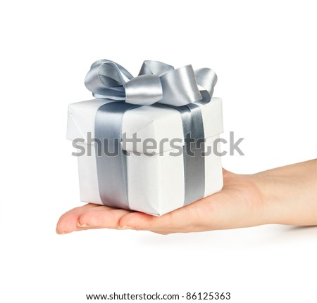gift box with silver ribbon in hand - stock photo