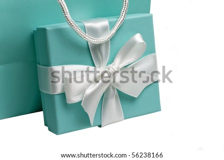 Gift box with white bow and gift bag on white background - stock photo