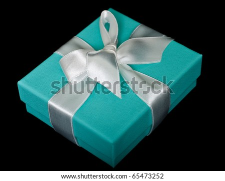 Gift box with white bow on black background - stock photo