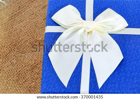 Gift Box with White Ribbon - stock photo