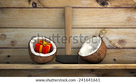 Gift box within half coconut on a wooden shelf - stock photo