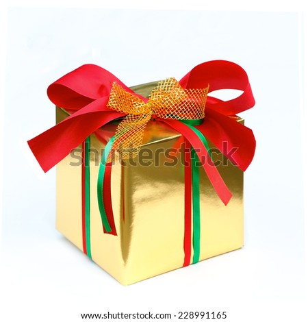 gift box wrap gold paper with red ribbon and isolated background