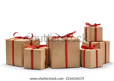 Gift box wrapped in recycled paper with ribbon bow - stock photo