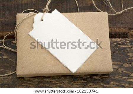 gift box wrapped in recycled paper, with ribbon bow,  with ribbon rustic