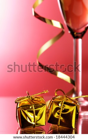 Gift boxes and champagne over red background - stock photo