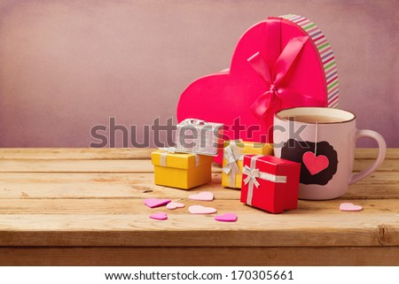 Gift boxes and cup of tea for Valentine's day - stock photo