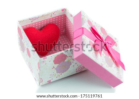 Gift boxes and red heart isolate on white background