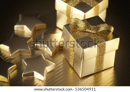 Gift boxes and stars on golden background
