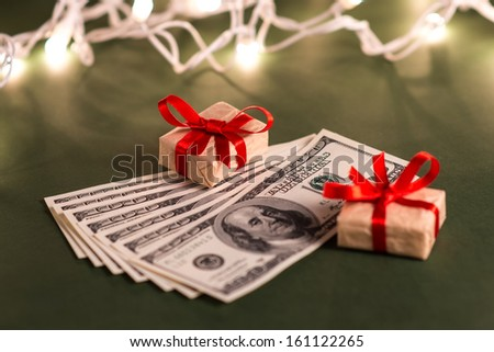 Gift boxes and US dollar bills - stock photo