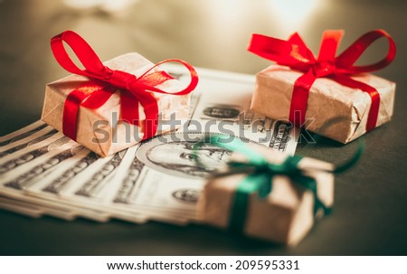 Gift boxes and US dollar bills. Toned picture - stock photo