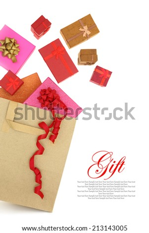 Gift boxes coming out of a shopping bag - stock photo