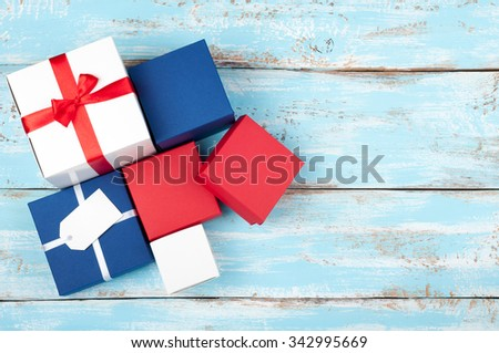 Gift boxes. Gift presents on wooden background. A lot of copy space. Top view - stock photo