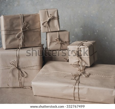 Gift boxes in kraft paper tied with twine, lifestyle, holiday, gift, celebrate, greeting - stock photo
