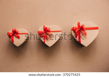 Gift boxes in the shape of heart on Valentine's Day. - stock photo