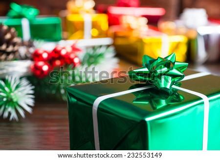 Gift boxes next to christmas tree - stock photo