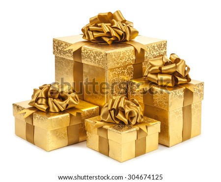 Gift boxes of gold color isolated on white background. - stock photo
