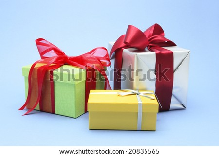 Gift Boxes on Blue Background - stock photo