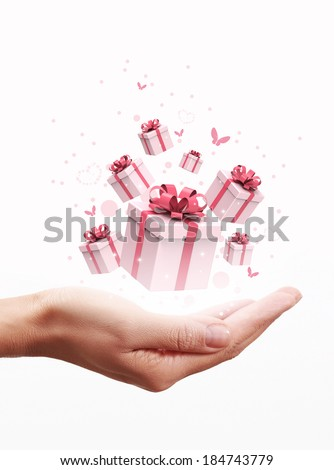 Gift boxes on hand - stock photo