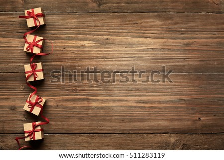 Gift Boxes on Wood Background, Birthday Holiday Presents, Red Ribbon Bow over Wooden Decoration