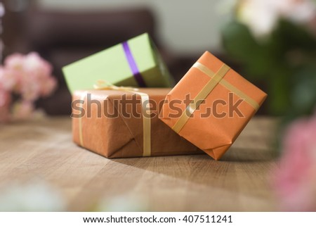 Gift boxes on wooden table at home - stock photo