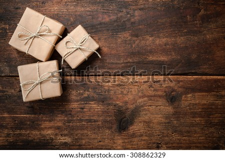 Gift boxes over dark wooden background - stock photo