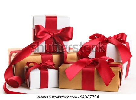 Gift boxes tied with a red satin ribbon bow. - stock photo