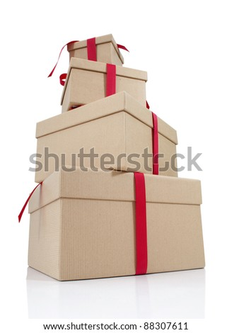 Gift boxes tied with red ribbon - stock photo
