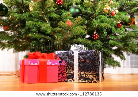 Gift boxes under the Christmas tree - stock photo