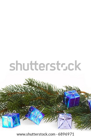 Gift boxes with a fur-tree branch on a white background